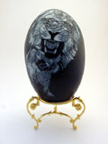 Lions carved emu egg